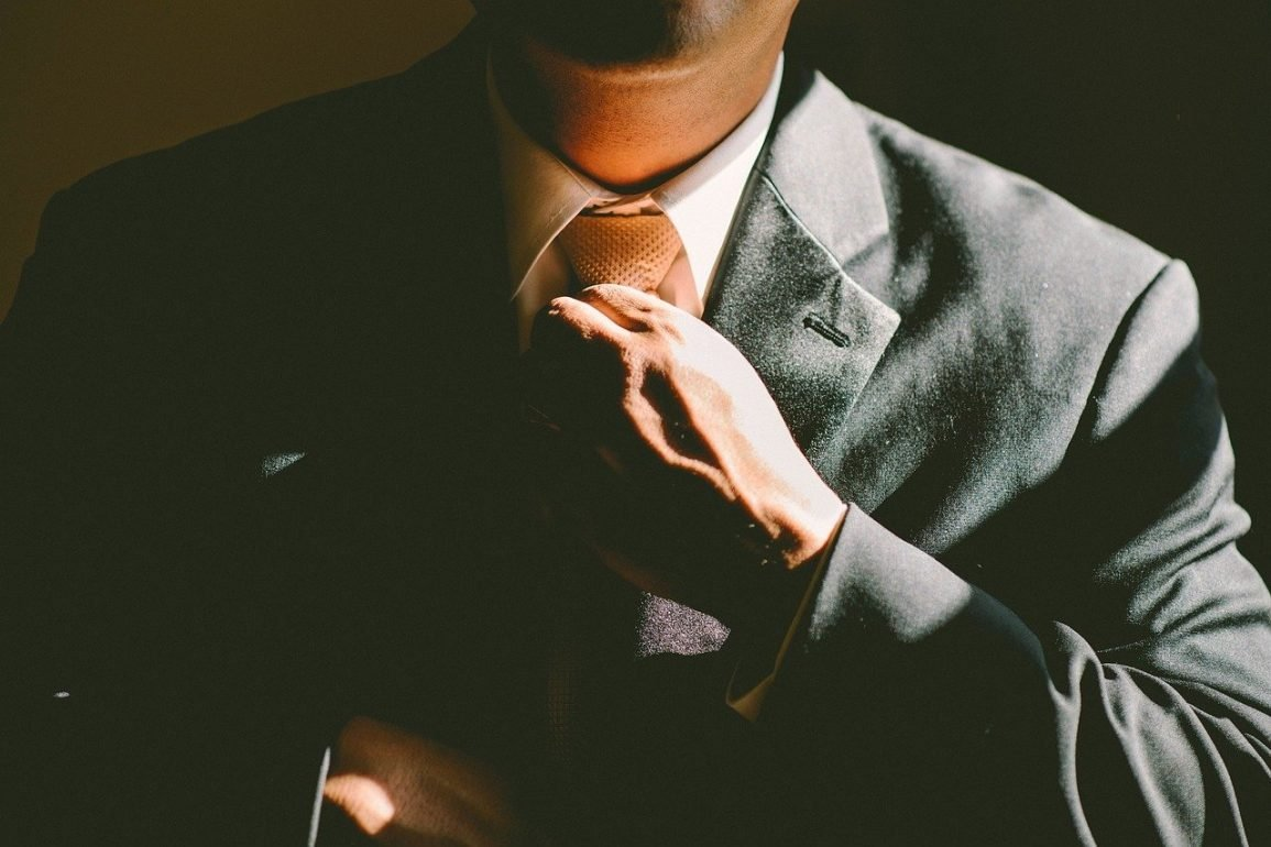 This shows a man in a business suit