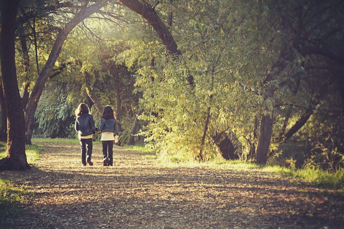 This shows children walking down a path