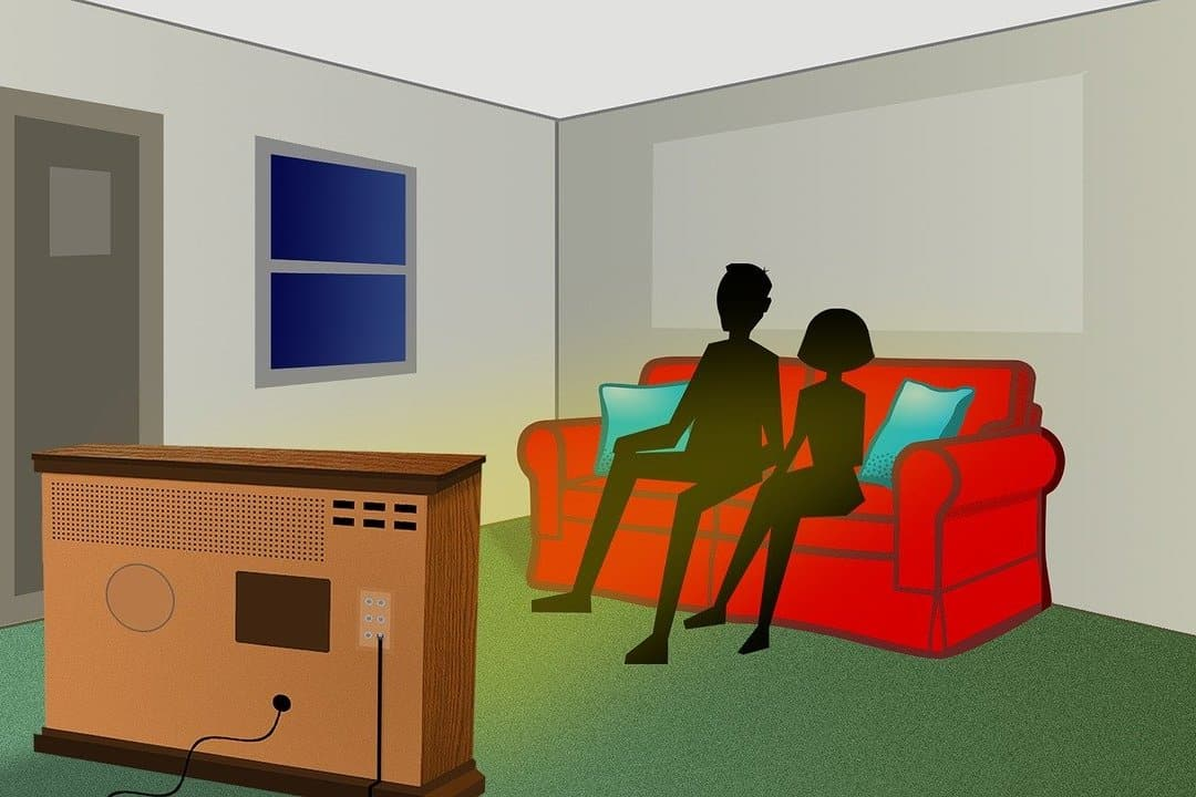 This is a cartoon of people watching TV