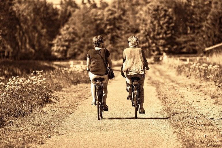 This shows two women riding bikes