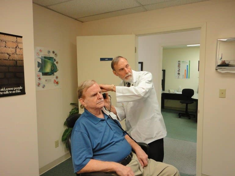 This shows a man having a hearing test
