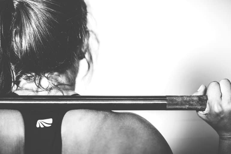 This shows a woman lifting weights
