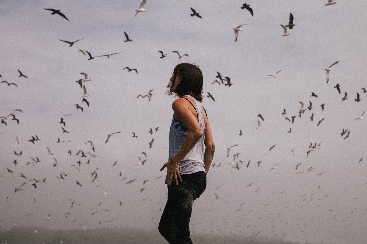 This shows a woman surrounded by birds