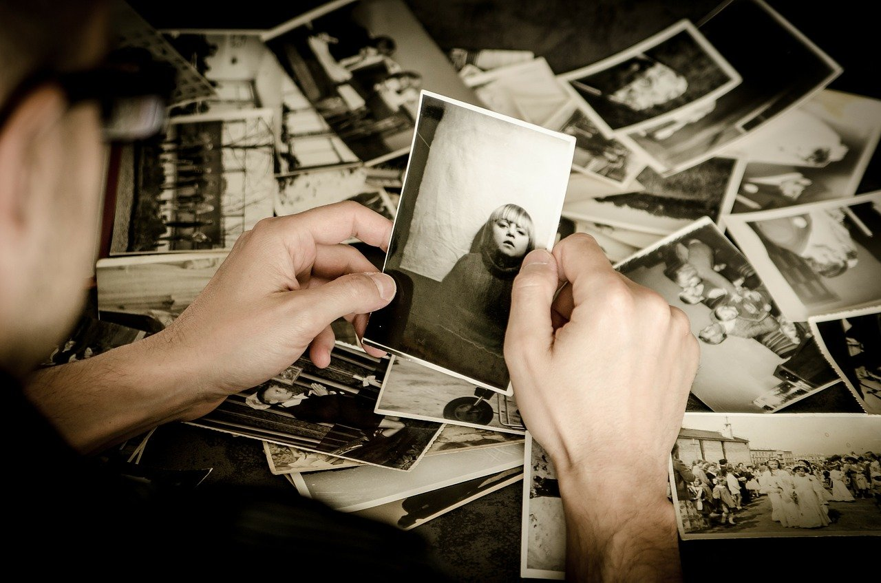 This shows a person sorting through old photos