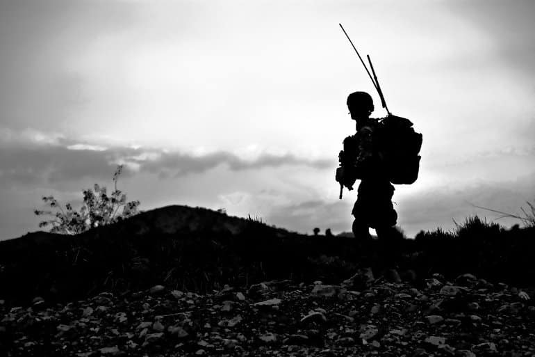 This shows a soldier on patrol