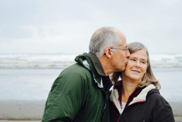 This shows a happy looking older couple at a beach
