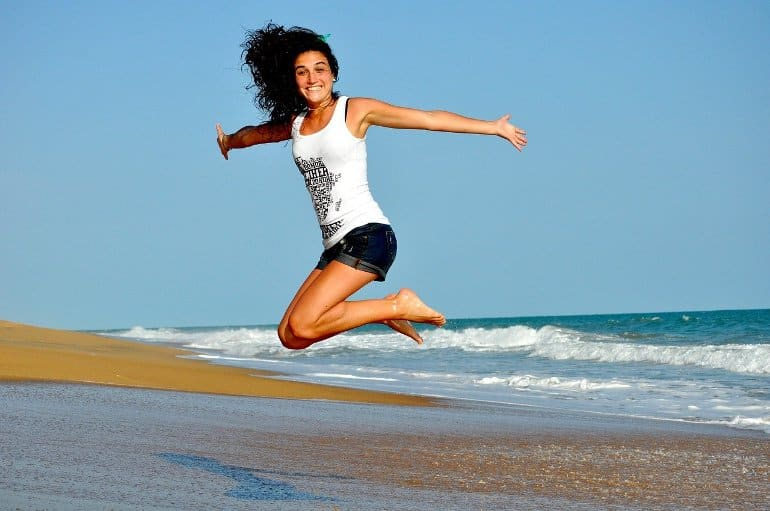 This shows a happy woman at a beach
