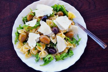 This shows a pasta salad with olives and feta cheese