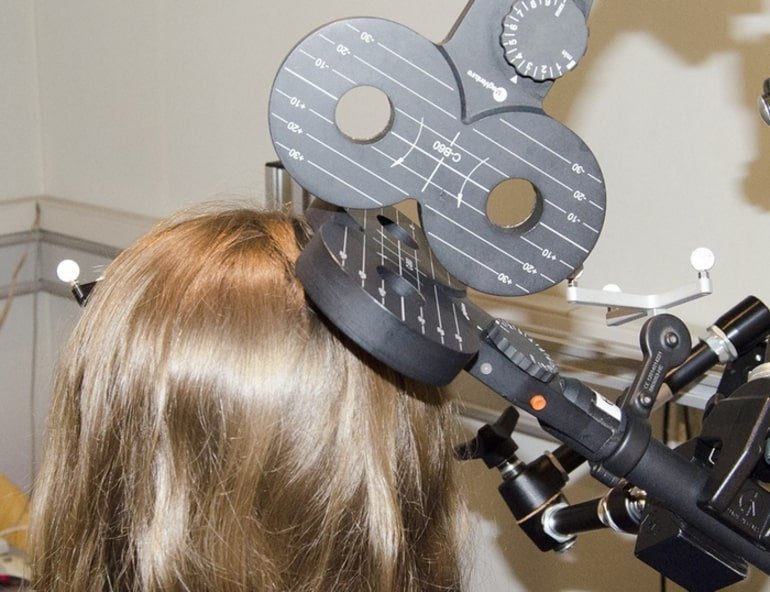 This shows a person using a tms machine