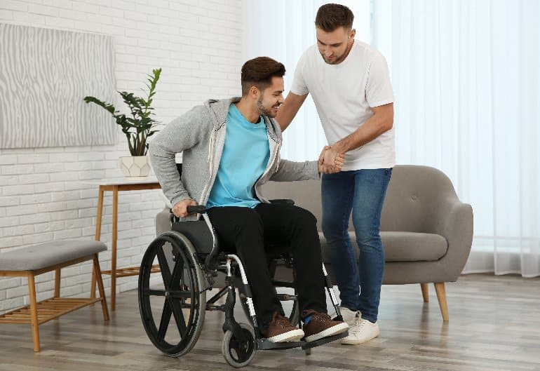 This shows a young man in a wheel chair