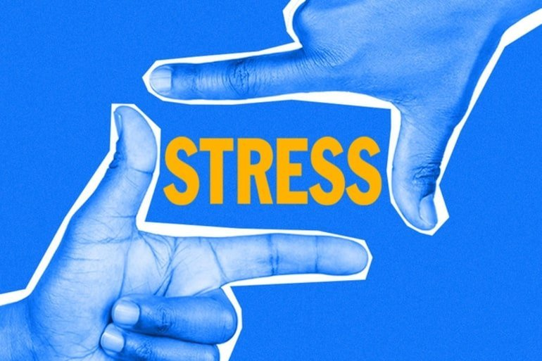 This shows fingers making a box with the word stress written inside