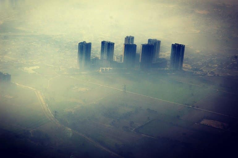 This shows a smoggy city skyline