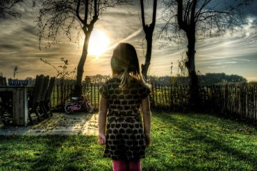 This shows a little girl standing alone