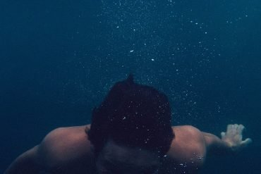 This shows a man swimming