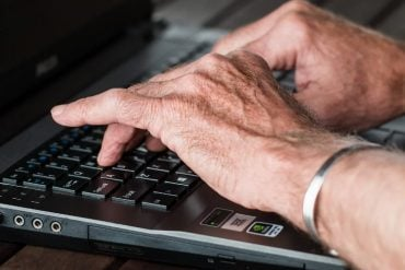 This shows a man with arthritic hands typing