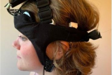 This shows a woman in the headband device