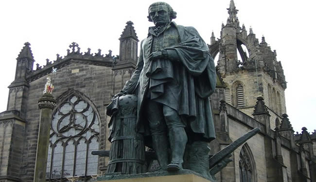 A statue of Adam Smith is shown.