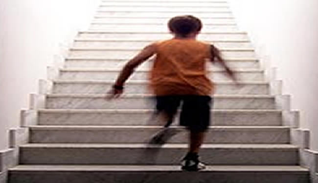 A boy is shown running up stairs.