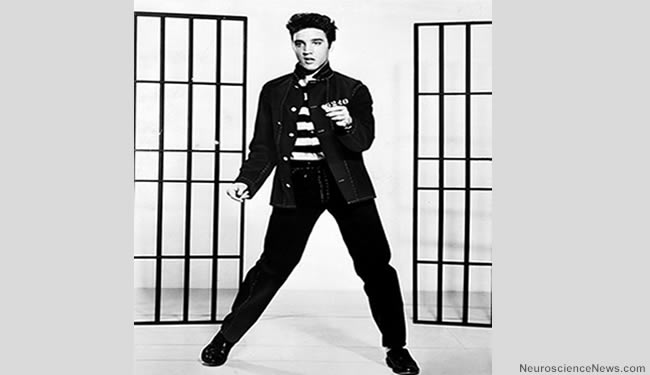 An image of Elvis Presley between sets of jail bars is shown.