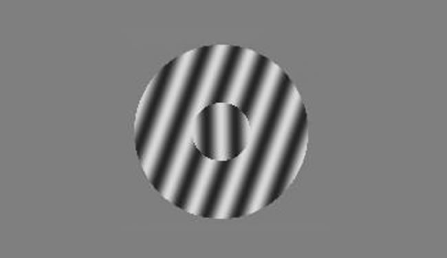 A large circle with different colored stripes going from low left to high right is shown with a smaller circle in the middle of it. The smaller circle in the middle has stripes that appear to be going from high left to low right (counterclockwise).